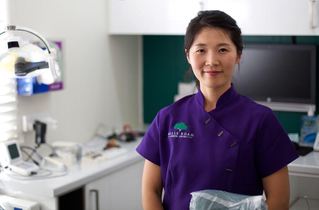 Min Song, dental assistant